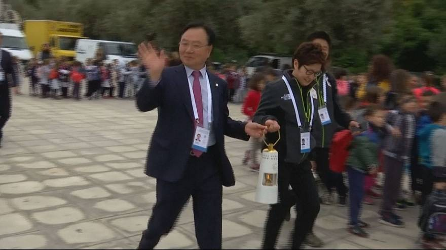 Greece gives Olympic flame South Korean sendoff