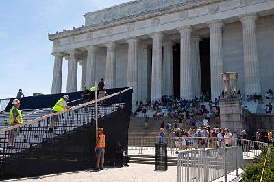 """Workers build a stage and bleachers for the """"Salute to America"""" event at the Lincoln Memorial on the National Mall in Washington on July 1, 2019."""