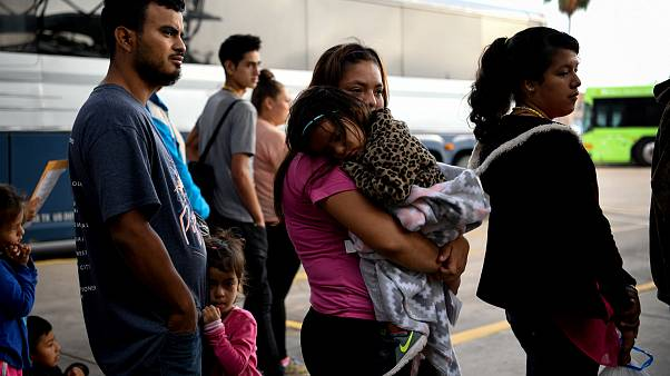 Image: Migrant families are released from detention in McAllen, Texas, on M