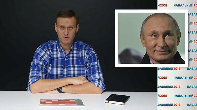 Navalny says he will sue Putin