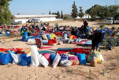 Migrants wait with their belongings at a detention center that was hit by an airstrike in the Tajoura suburb of Tripoli on July 3.