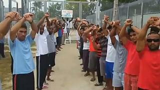 Desperate refugees in Papua New Guinea protest detention conditions