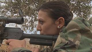 The female Syrian lecturer trading books for guns