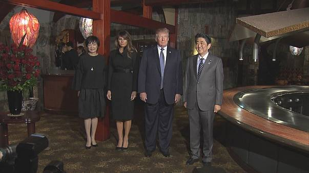 Trump and Abe talk trade and golf tactics at start of Asian tour