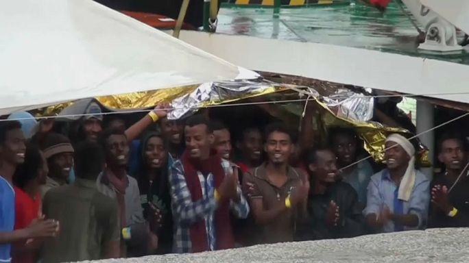 Migrants celebrate arrival in Italy