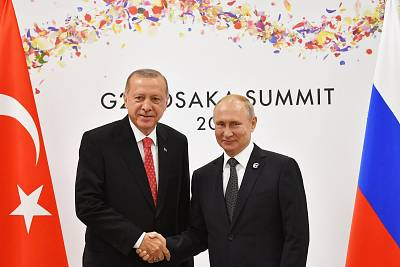 Russian President Vladimir Putin greets Turkish President Recep Tayyip Erdogan, left, on the sidelines of the G-20 leaders summit in Osaka, Japan.