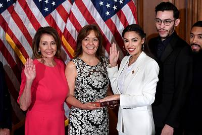 Speaker of the House Nancy Pelosi performs a ceremonial swearing-in for U.S. House Representative Alexandria Ocasio-Cortez, D-NY at the start of the 116th U.S. Congress at the U.S. Capitol on Jan. 3, 2019.