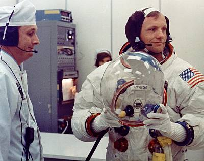 Apollo 11 commander Neil Armstrong suits up for launch with an assist from suit technician Troy Stewart on July 16, 1969.