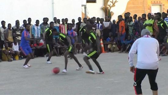 Migrant football tournament eases misery of Libya journeys [no comment]