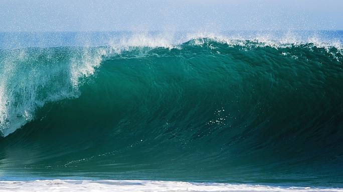 British surfer breaks back in 60-foot wave wipeout