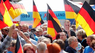 Image: People attend an election campaign event by Germany's far-right Alte