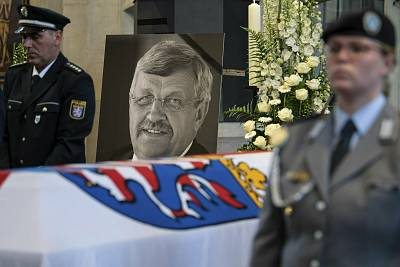 A photo of politician Walter Luebcke stands behind his coffin during his funeral service in Kassel, Germany.
