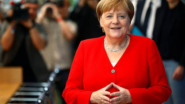 Image: German Chancellor Angela Merkel holds the annual summer news confere