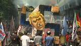 Swastika-shaped Trump effigy set on fire in Manila