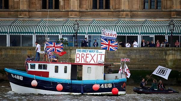 Image: A boat decorated with flags and banners from pro-Brexit Fishing for