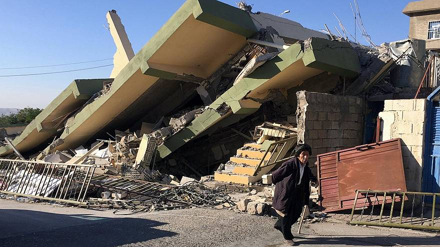 Cracks in the road and gutted houses in quake-hit eastern Iraq