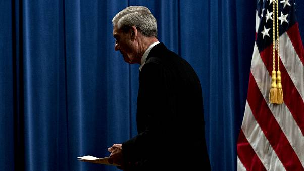 Image: Robert Mueller departs a news conference at the Department of Justic