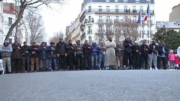 Muslims clash with lawmakers on Paris streets