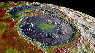 A gravity map of the moon's southern latitudes overlaid on terrain based on