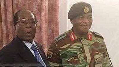 Mugabe meets army chief and 'peace' emissaries, standoff reported