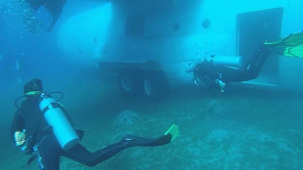 Jordan scuttles military transport plane to make new diving reef  for tourists