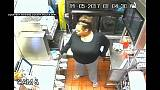 Watch: Woman climbs drive-thru to steal food and Happy Meal toys