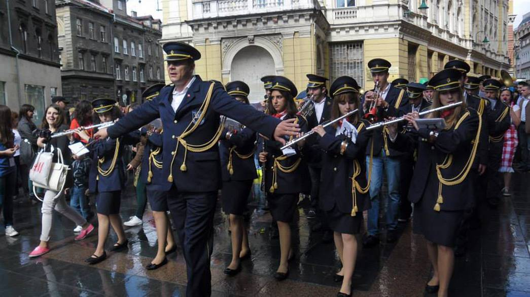 As communist relics collapse, the band continues to play