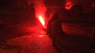 Woman struck by lit flare during Greek protest (warning: graphic content)