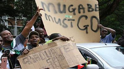 Zimbabwe's ruling party set to sack Mugabe on Sunday, as protesters march in Harare