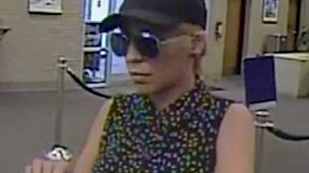 "Image: Police are searching for a suspect, dubbed the ""Pink Lady Bandit,"" w"