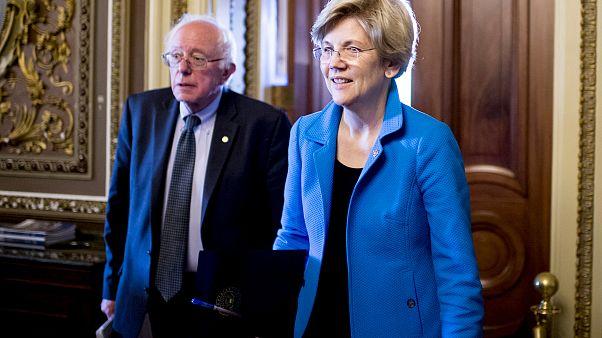 Image: Sen. Bernie Sanders, I-VT, and Sen. Elizabeth Warren, D-Mass., leave