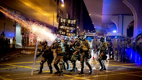 Image: Riot police fire tear gas during demonstrations in Hong Kong