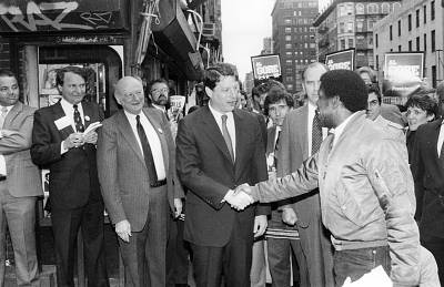 New York City Mayor Ed Koch and Democratic presidential candidate Al Gore meet locals in Manhattan on April 18, 1988.