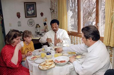 Presidential candidate Jesse Jackson joins the Becker family for breakfast while campaigning in Cudahy, Wisconsin, on March 31, 1988.