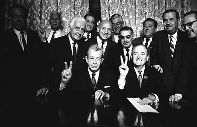 Sen. Everett Dirksen, bottom left, and Sen. Hubert Humphrey, bottom right, pose with fellow senators after passing a vote for cloture on the Civil Rights Act in 1964.