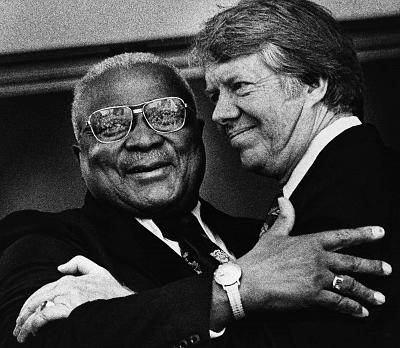 Rev. Martin Luther King, Sr., hugs Democratic presidential candidate Jimmy Carter in Atlanta on April 13, 1976.