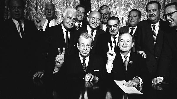 Image: Sen. Everett Dirksen, bottom left, and Sen. Hubert Humphrey, bottom