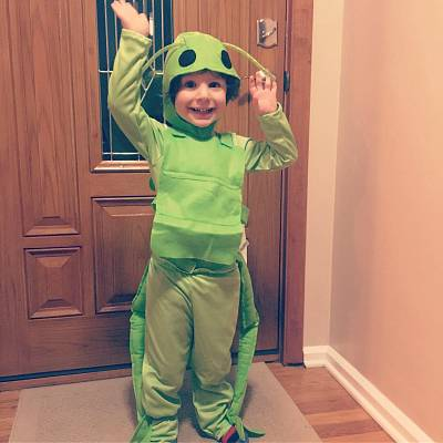 Alec Sutton, 4, knows his dad wrote him a book, which he calls the grasshopper book. Alec is pictured here wearing a grasshopper costume for Halloween.