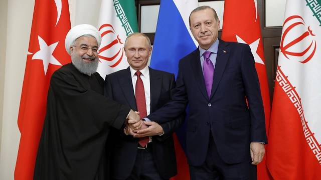 Russia hails beginning of end of Syrian conflict after talks with Turkey and Iran