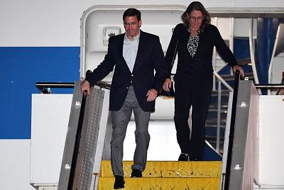 Defense Secretary Mark Esper and his wife Leah arrive at Sydney Airport on August 3, 2019.