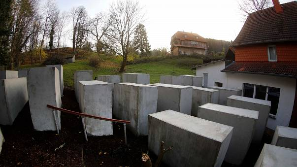 Activists build Holocaust memorial replica outside German far-right politician's home