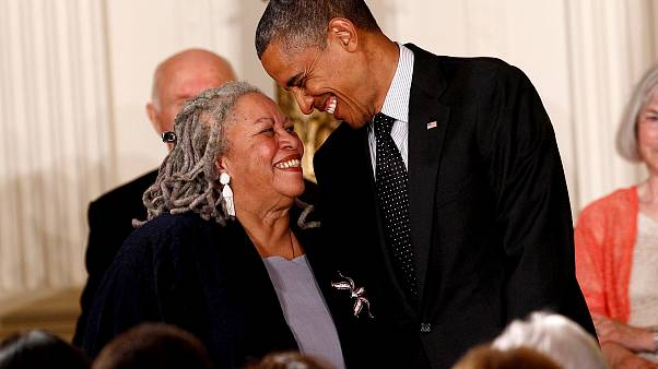 Image: Toni Morrison smiles with President Barack Obama during a Medal of F