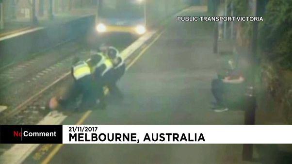 CCTV captures woman's near miss on train tracks
