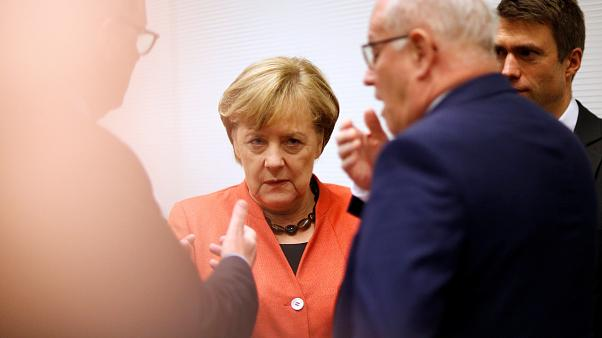 Merkel plays down talk of new elections as German 'Grand Coalition' gathers pace