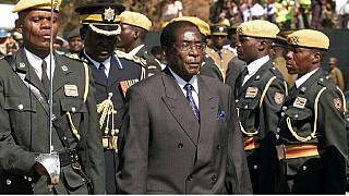 "Maybe angels wept, but Mugabe ""glowed"" with relief after he quit: priest"