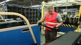 Slovakian PM works night shift in factory, says workers can expect salary bonuses