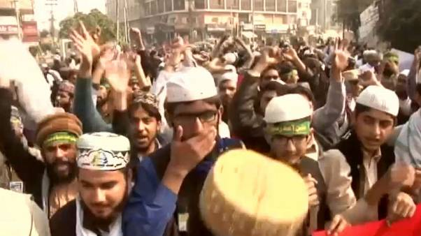 Pakistan protests halted as law minister resigns