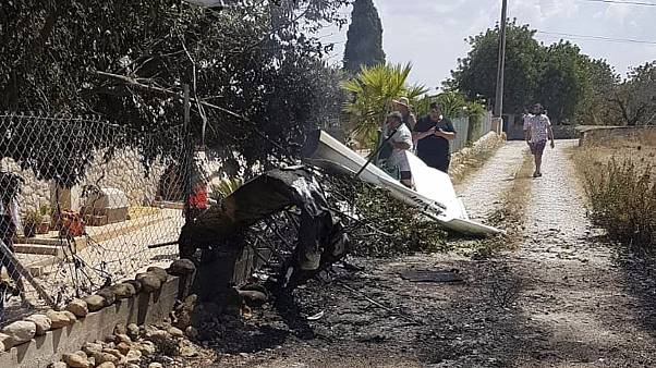 Image: The wreckage after a helicopter and small plane collided in Mallorca