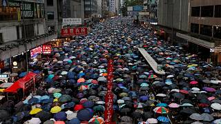 Image: People march during a rally to demand democracy and political reform