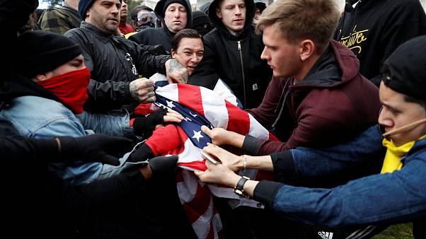 Image: Protesters fight for a U.S. flag
